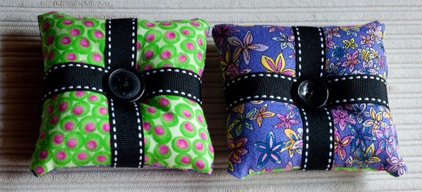 Green and purple pin cushions