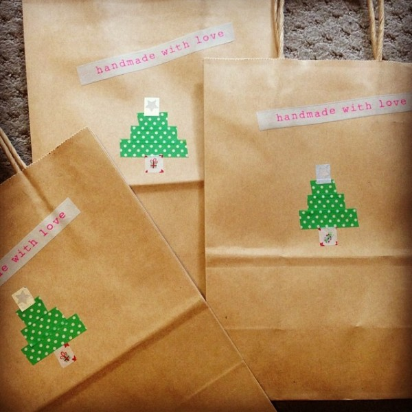 Xmas gift bags decorated with washi tape