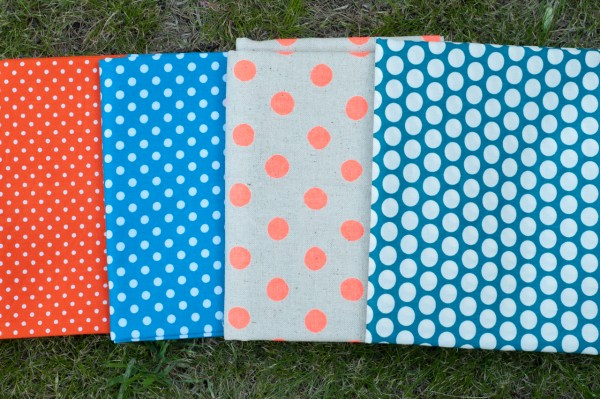 Polka dot fabric in blues and oranges